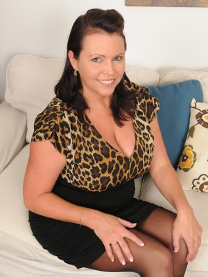 39 year old Angelica Sin paws her giant mounds on her daybed