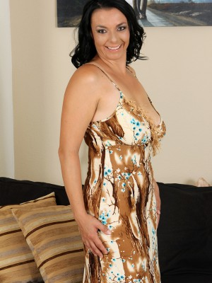 Brunette hair 35 year old Leona Sweet from AllOver30 opens her gams wide