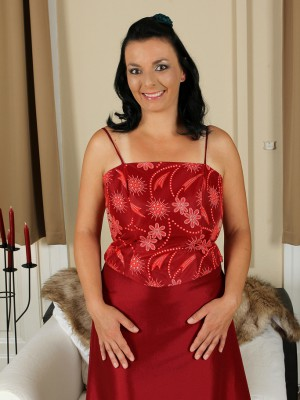 Lustful 35 year older Leona Tasty slides from her elegant garments here