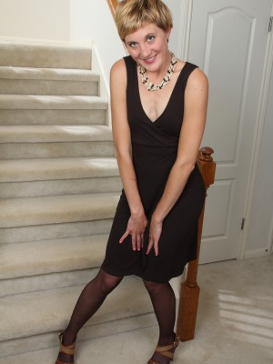 Diminutive plus aged Katrina Mathews  opening up her gams found on the stairs