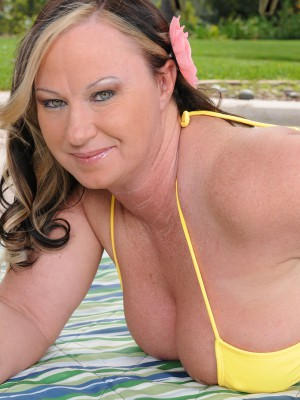 Breasty 42 year aged Mary Jane gets totally naked out inwards the backyard