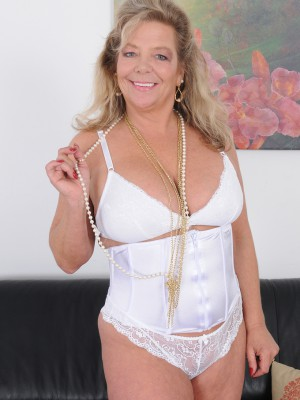 Popular blond Karen Summers from pornography past undresses from her underware