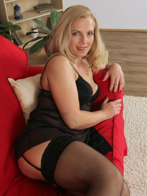 47 yr old Britney from AllOver30 develops her stocking covered gams
