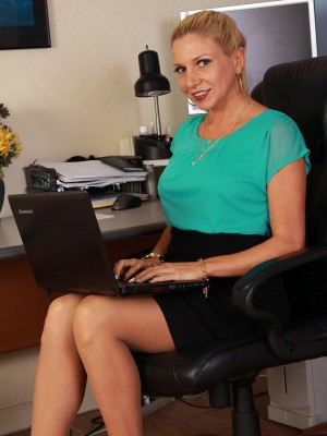 31 year old Jessica Taylor pieces from her stockings at the lady office desk