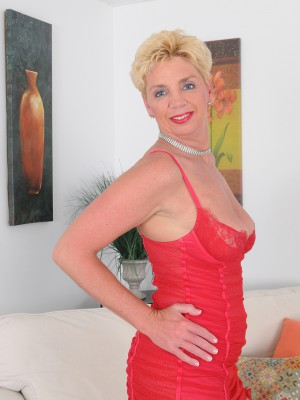 Blond 47 year old Taylor Lynn in red knickers widening the doll long gams