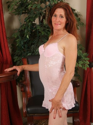 46 yr old and redheaded Monica E slides from the girl slinky ligerie