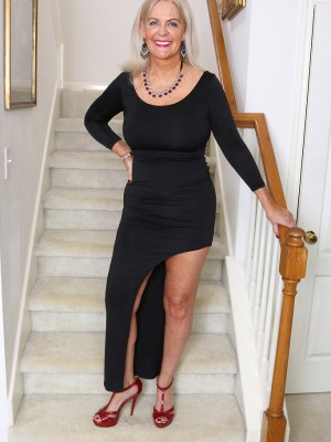 Glamorous 58 yr old Judy Mayflower having fun with the girl titties regarding stairs
