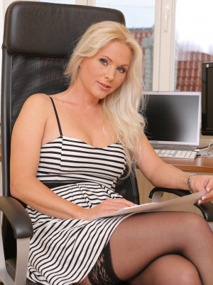 Golden-haired 36 yr old Marlene opens up the lady gams wide on her workplace chair