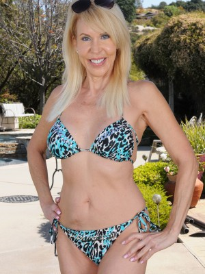 60 yr old Erica Lauren starts up the girl aged company ass in the backyard
