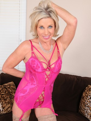 53 yr old Payton Hall undresses off the chick pink lingerie to exposed wide