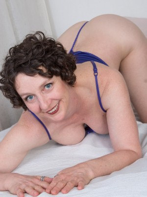 42 yr old Artemesia from AllOver30 toying her aged wooly pussy
