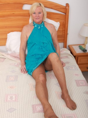 49 yr old Sabine catapulting a huge blue vibrator to the girl aged cell