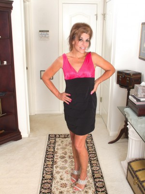 Cute small 49 year old Nicole Newby extends the woman gams and pussy wide
