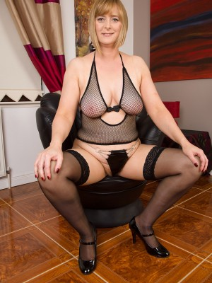 Buxom April Wraps Her Hawt Milf Kinks in Fishnet