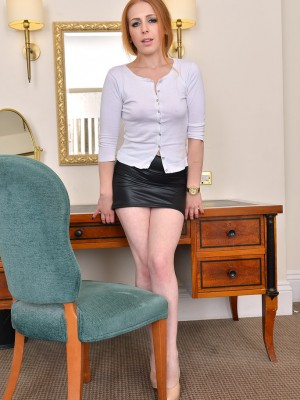 Stunning redhead honey Tia Jones slides through the lady suit and widens her gams