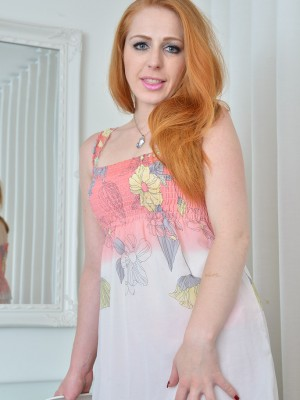 Glamorous redhead Tia Jones will need off her red nightie showing that hairy pussy