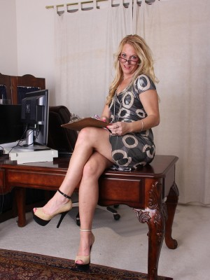 Golden-haired associate Jackie stays later at the office to eradicate and play