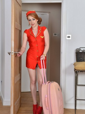 Glamorous redhead stewardess Tia Jones gets home and flashes the lady shaggy hole
