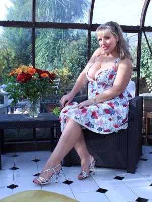 Chesty cutie Danielle T takes off a flower gown to experience along with her huge boobs