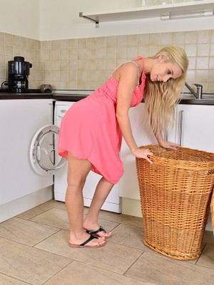 Stunning blonde Nesty does some washing and flashes the lady perfect form