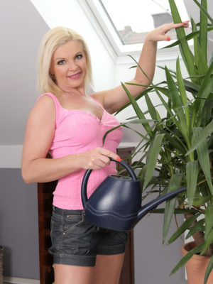 Big breasted golden-haired Carolina Carla waters the woman plants and performs