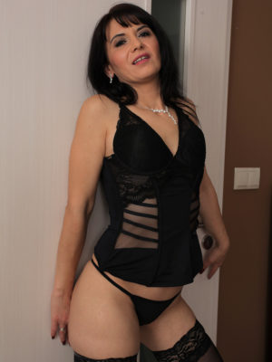 Slutty Latin chick MILF Gracia Saluda looks stunning in haunch high nylons and a thong