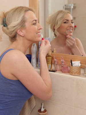Blond Eve Valentine admires by herself in mirror