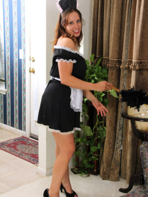 Kinky female house servant Cassandra Johnson dusts and disrobes