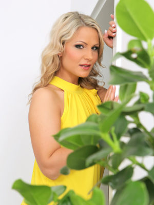 Beautiful blond Holly B waters the lady plants