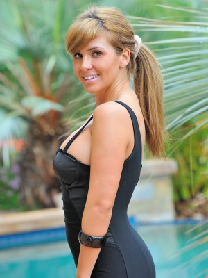 Patricia positions in a hot black dress