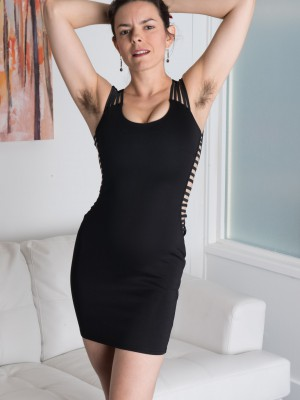 Erotic Lucia disrobes from black dress to play undressed