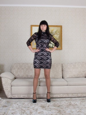 Tayra Jane will take off nude by her grey daybed