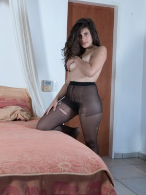 Sally unwraps down nylons while laying in her own sleep