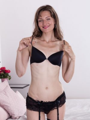 Lulu strips off her black lingerie in bed