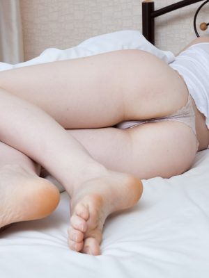 Alexandra awakens to strip naked in her bed