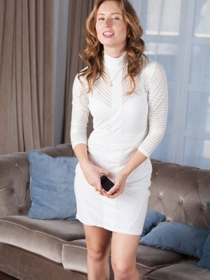 Nikky B models a white dress and gets naked