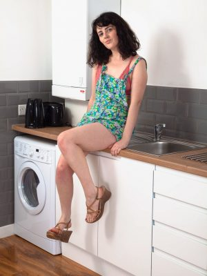 Dion strips naked while alone in her kitchen