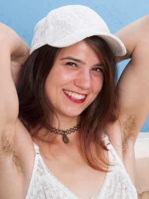 Aislynn strips off her white cap and lingerie
