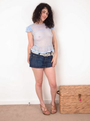 Dion takes off her jeans skirt to unwind naked