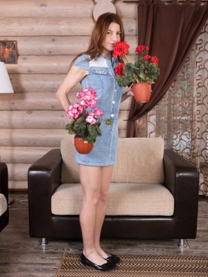 Atisha strips naked after watering her plants