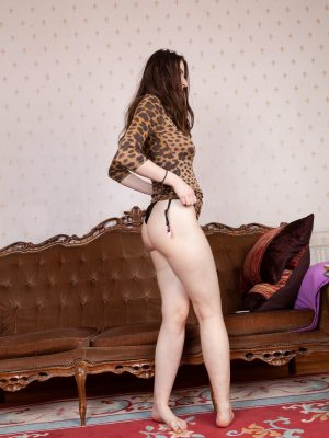 Marika Di strips naked on her brown couch