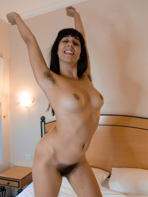 Violet Russo masturbates with a toy in bed