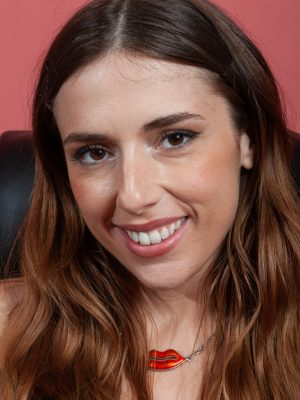 Simone strips nude while sitting at her desk