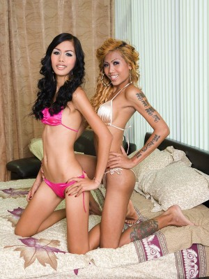 Two Naughty Ladyboys Get Nude And Fuck Around With Each Other