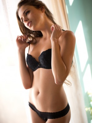 peels off out of her ebony bra and pants