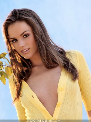 disrobes out of her yellow T-shirt and white underware
