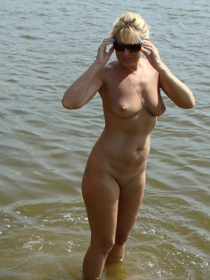 Sexy blonde Milf bare about beach
