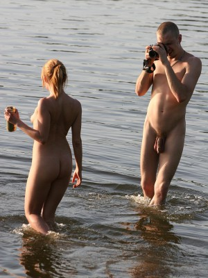Wild couple creating a naked beach video