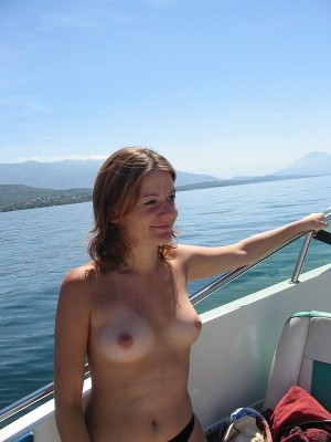 Dirty blond hottie goes sailing and then gets nude on shore.
