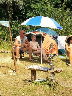 Nudist group having a great time at beach